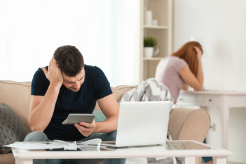 Depressed couple with money problems after quarrel at home