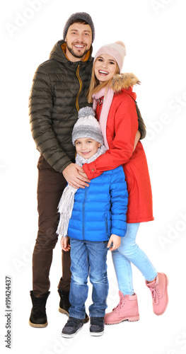 Happy family in warm clothing on white background ready for Warm winter family vacations