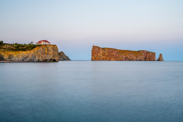 Percé Rock with sunset light as viewed from the town of Percé (Canada, Québec)