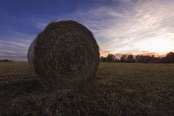 Hay bale at sunset