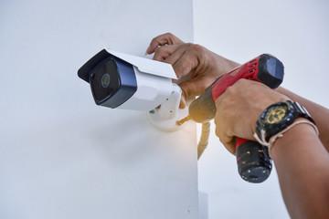 Teachnician installing CCTV camera System for security area.