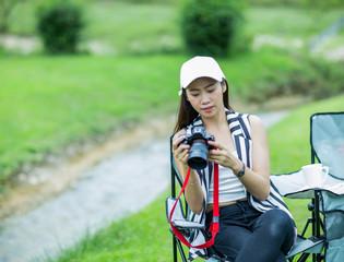 Asian girl checking photo on camera