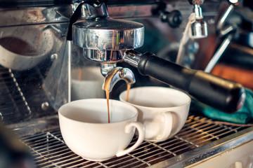 Coffee Maker making coffee flowing in cup