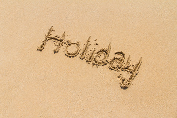 Word of Holiday on Sand