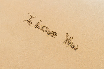 Word of I Love You on Sand