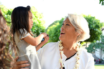 Hawaii Lieutenant Governor candidate Iwamoto shares a moment with her 5 year old daughter in Honolulu