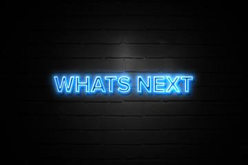 Whats Next neon Sign on brickwall