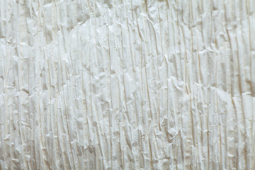 Bright crepe white paper texture background close up