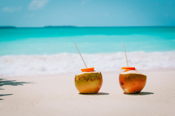 two coconut drinks on tropical beach vacation Wall mural