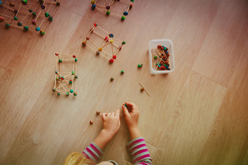 little girl making geometric shapes, engineering and STEM education