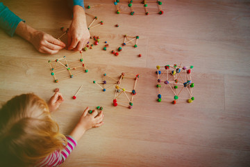 teacher and kids making geometric shapes, engineering and STEM education