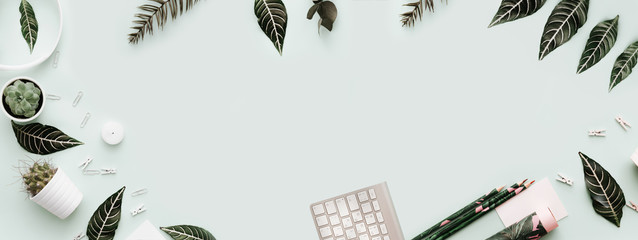 Banner with Neutral Styled Desk Scenes for Designers, Bloggers. Flat Lay with keyboard and green tropical  leaves
