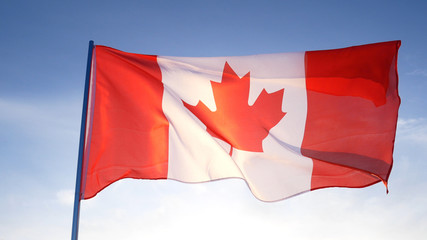 Canada flag on clear blue sky