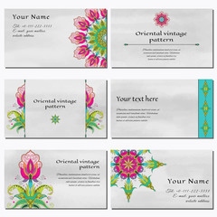 Set of six horizontal business cards. Oriental fantastic floral pattern on watercolor background. Hand drawing. Place for your text.