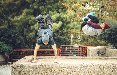 Jumping athletes training parkour