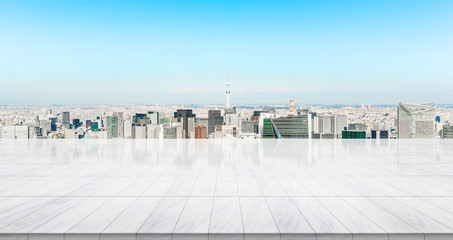 Wall Mural - Business concept - Empty marble floor top with panoramic modern cityscape building bird eye aerial view under sunrise and morning bright sky of Tokyo, Japan, for display or montage product.