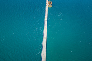 Aerial view of an Harbour pontoon in the sea, Greece.