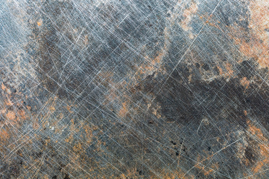 Grunge metal background with scratches and rust