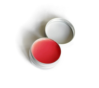 red lip balm in the container