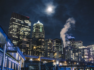 Night Cityscape Looking Up Buildings and Cloudy Moon