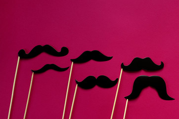 photo props - black paper mustache on pink  background