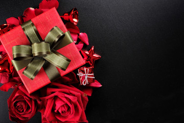 Happy Valentine's Day Concept with red roses, gift boxes and space for text
