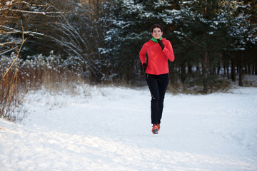 Photo of sports girl on morning run in winter park