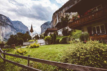 Great view of alpine village. Location Swiss alp, Lauterbrunnen valley, Staubbach waterfall.