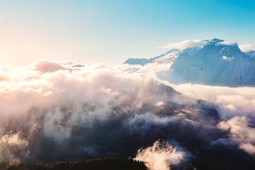 Creamy fog covered the glacier Marmolada. Location place Val di Fassa valley, passo Sella, Dolomiti, Italy.