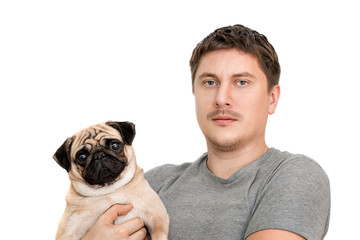 The man is holding a pug
