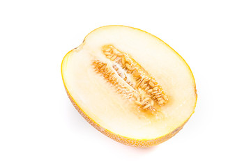 Half honeydew melon tropical fruit isolated on a white background.