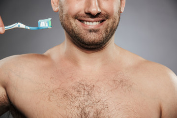 Cropped image of a happy shirtless man