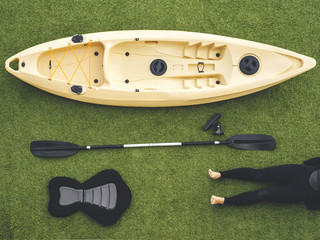 Kayak still life, boat, paddle, seat and woman legs on wet suit