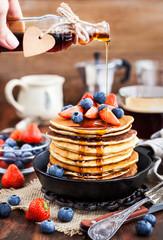 Stack of freshly prepared banana  pancakes with fresh berries