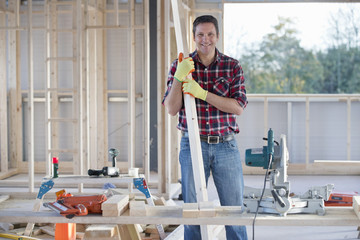 Portrait of carpenter on indoor building construction site