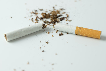 Stop smoking by breaking the cigarette or hand crushing cigarette quitting smoking concept