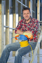 Portrait of electrician on building construction site interior