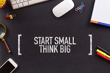 START SMALL THINK BIG CONCEPT ON BLACKBOARD