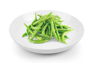 green beans in plate on white background
