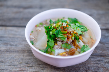 Rice boiled with pork garlic and coriander bowl