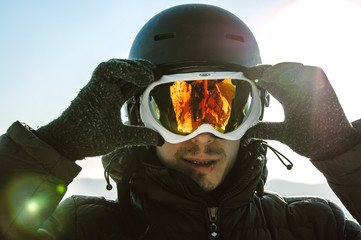 skier with glasses and helmet