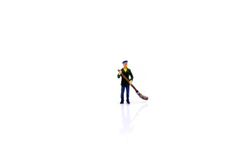Miniature people : Cleaning personnel with white background.