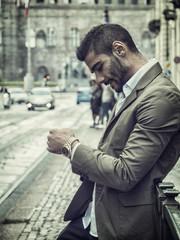Attractive man outdoor wearing elegant jacket, in European city, Turin in Italy