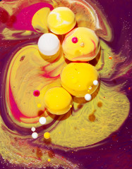 Little balls of Airbrush-Ink in liquid paraffin forming amazing abstract picturs