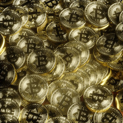 Bitcoin golden coins laying on table