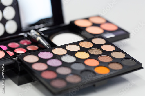 Backgrounds of Cosmetic makeup set on table.