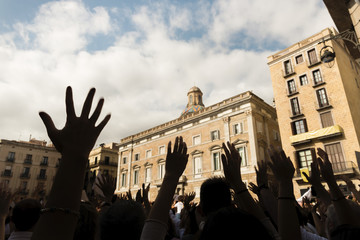 People standing up for their rights with hands up