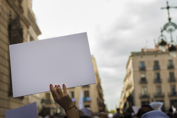woman's hands holding banner during demonstration