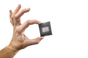 Delidded CPU with old thermal paste and glue in man's hand isolated on white background.