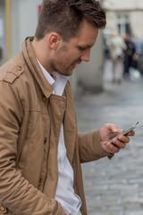 man writes sms